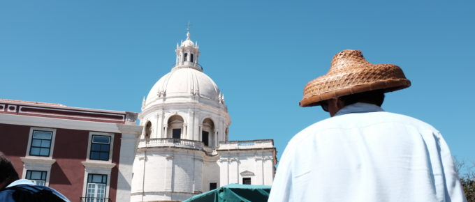 man with a funny hat in Lisbon